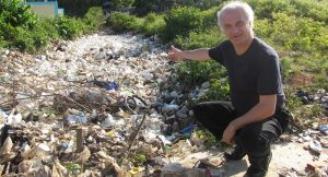 Dr. Mark Terry in the Dominican Republic with plastic river